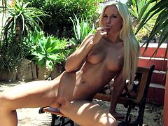 A slim girl takes off her clothes and a bikini off in a garden. This babe fondles her nice tits and also finger fucks the pussy sitting on the bench.