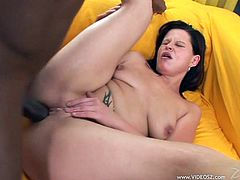 Make sure you have a look at this hardcore scene where this horny brunette is nailed by this guy's black monster cock.