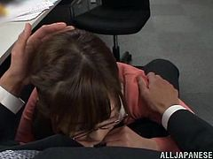 Salacious Japanese office girl Chika Kitano is having fun with some dude at her work place. She gives a blowjob to the dude and then bends over a desk and gets her cunt slammed.