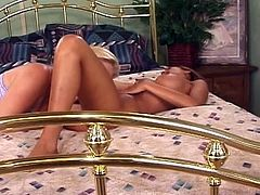 These two seductive lesbians make love with a strap on dildo while also licking and fingering their cunts in this video.