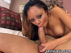 Hot Annie Cruz deep-throating a shaved cock.