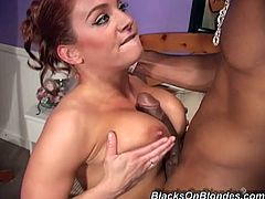 Kinky redhead milf Gabriella Banks gives a deepthroat blowjob to a black dude. Then she sits down on his wang and they fuck in reverse cowgirl position.