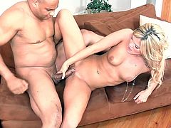 Have a good time watching this blonde chick, with natural breasts wearing high heels, while she gets nailed hard by a lusty man over a couch.