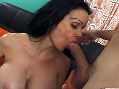 Big boobed MILF in black stockings fingerfucks her hairy cooch, then kneels down and gives her boyfriend an amazing blowjob.
