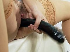 Huge black toy disappears in hairy pussy of one sex insane chick. She spreads her legs wide open and drills her deep pussy with gigantic sex toy.
