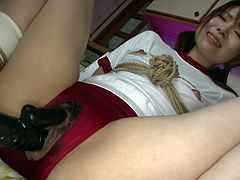 Bondage Japanese girl Naosima Ai gets her muff stuffed