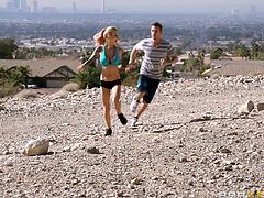 Sport is everything for Sarah! She's an athletic blonde with a slim, fit body and a pair of big naughty boobs. She runs in the desert with this guy and then in the city. The dude barely keeps it with her but after they arrive home, she repays him for his effort and gets her boobs groped. Is she an athlete in bed too?
