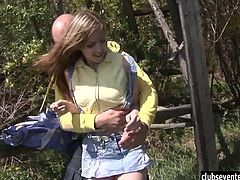 This bald guy follows teen Abby in the forest and when the moment is right, he takes her in his arms and starts fondling her. Next thing you know, she's riding his cock.