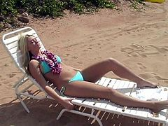 Well-endowed blonde hottie Alison Angel wearing a bikini is having a good time at a beach. She gives an interview and demonstrates her amazing body.
