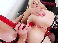 Adorable blonde babe Holly Hanna with slim body and pink nails in stockings and sexy undies gets tight ass stuffed with huge rubber dildo by busty redhead whore Audrey Hollander.