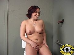 Masturbate watching this chubby redhead, with big boobs wearing a miniskirt, while she sucks a big black rocket in a dirty toilet.