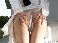 Slim Japanese milf Rino Yoshihara wearing a swimsuit is having fun with some guy outdoors. They make out ardently and then have oral sex and fuck in missionary position and doggy style.