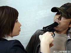 Stunning Sayuki Kanno catches a burglar in the storage. Sayuki has a gun, that is why he has to do everything she wants. The guy takes off his clothes and gets his dick stroked by the hot office chick.