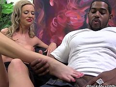 Have a good time watching this blonde girl, with big breasts and red lips, while she slurps a black guy's pipe and acts really naughty.