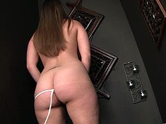 A hot busty bitch sucks on a big black cock through a gloryhole and takes all the sticky jizz in her mouth. Check it out!