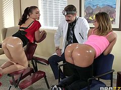 doc inspects two big and oiled asses