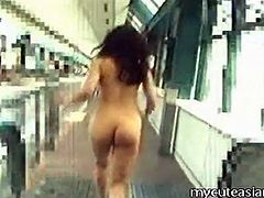 Asian girl strips fully nude in public place