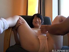 A sexy Japanese babe gets her panties pulled off, her tits rubbed, and then she gets her hair pussy finger fucked by a lucky guy.