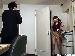 Cute Japanese office girl Minami Hirahar wearing pantyhose is getting naughty with some man indoors. She lets the guy rub her pussy and pound it deep from behind.