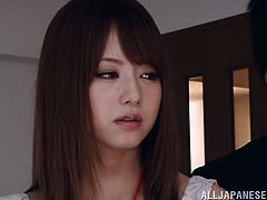 Adorable Japanese girl wearing pantyhose and a miniskirt is playing dirty games with some guy indoors. She makes out with the guy and then enjoys cunnilingus and fingering.
