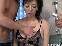 Well, she is milf and threesome with two men is not something new for her! She blows one dick, while the other one pokes her muff.