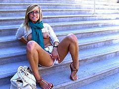 Nasty blonde chick Kennedy is having fun in the street. She pleases herself with fingering on the stairs and then takes her shorts off and demonstrates her hot ass.