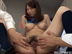 A gorgeous Japanese cutie gets a hard toy shoved up her moist hairy pussy in the locker rooms and then a teacher walks in on the action.