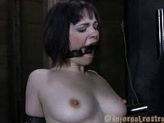 Madisin Moon looks best with a gag in her mouth in the piledriver position as a fucking machine penetrates her wet cunt. She gets wet because of all the tormenting.