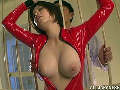 Sexy latex Japanese bitch Kaede Fuyutsuk lets some guy play with her coochie. Then they
