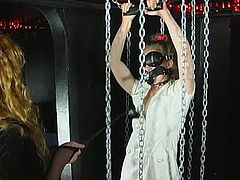 Chained chick has nothing to do but fuck horny mistress with strapon. She does her best 'cuz she is afraid of punishment and tortures.