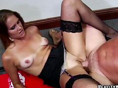 Press play to watch this long haired cougar, with natural breasts wearing sexy lingerie and black stockings, while she gets drilled hard.