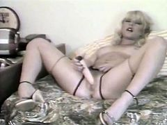 Lusty blond haired filth Danielle pokes her kitty with big dildo
