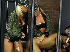 Take a look at this hot clip where these smoking hot marines show this prisoner an amazing time as they fuck him with large strapons.