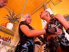 Two horny bitches seduce a fat dude cooking in the kitchen and start sucking on his cock together and get him to fuck their wet pussies in this hot bdsm threesome