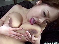Riai Sakuragi is a nice Asian babe with gigantic boobs. She takes off her pink lingerie and gets her wet pussy licked. Riai rides a dick and gets jizzed on her breasts.