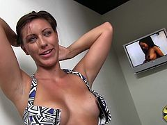 Rilynn Rae gave the guy doing her interview a treat when she unhooked her bra and unleashed her amazing, big tits while she talked.