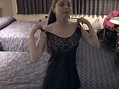 Have fun watching this long haired chick, with born boobs wearing a cute dress, while she gets blasted hard by a kinky guy over a hotel's bed.