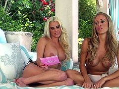 Two playful blonde girls show off their nice boobs