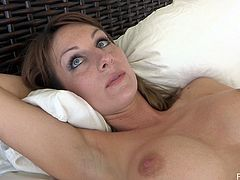 Striking Leann Plays With A Big Vibrator On Her Bed