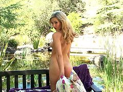 Admirable blonde girl Sophia Knight is playing dirty games in the garden. She demonstrates her beautiful body for the camera and then entertains herself by fingering her coochie.