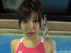 Admirable Japanese chick Tsukasa Aoi wearing a swimsuit is having fun with some guy in a pool. She sucks and rubs the dude's wang and lets him cum on her face.