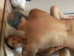 This horny maid knows how to please her customer. She sucks his swollen dick with great enthusiasm. Then he fucks her tight pussy in missionary position.