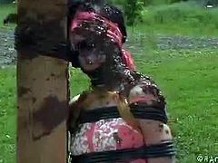 Elise Graves's master tortures her outdoors and throws her in sticky mud. Then, he takes her in his dungeon and torments her sore flesh while she's upside down.