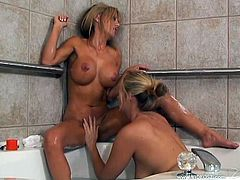 Angel Daisy and Cindy Pucci take the bath together. These hot MILFs also lick and finger each others wet pussies sitting in a bathtub.