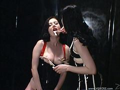 Anastasia Pierce and Smoking Mary Jane are two nasty lesbians in leather clothes. Anastasia gets her huge boobs licked and pinched with claws.