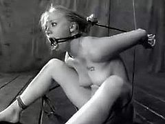 Watch this young 2o year old babe Tracy Sweet in this hot bondage video.See her naked and tied hard by the ropes in different positions and her tight pussy is fucked by big toys.She tries to escape the ropes but too bad for her that these knots could keep Houdini Bound.