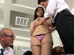 Pretty Japanese office girl Asuka and her colleagues are having fun indoors. The guys undress the bitch, touch her tits and pussy and then fuck her in missionary position by turns.