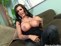 Captivating tattooed brunette milf Jenna Presley has awesome big boobs and she likes to demonstrate them. She takes her boobs out of her bra and strokes them passionately.