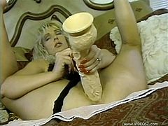 Make sure you check out this vintage video where a blonde milf shows off her big natural tits while wearing lingerie before she masturbates with a lartge dildo.