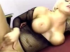 A stunning blonde MILF with big boobs plays with her pussy and gives a skillful blowjob. Jamie gets hammered in both holes. She moans and groans with pleasure. She loves deep and hard anal penetration.